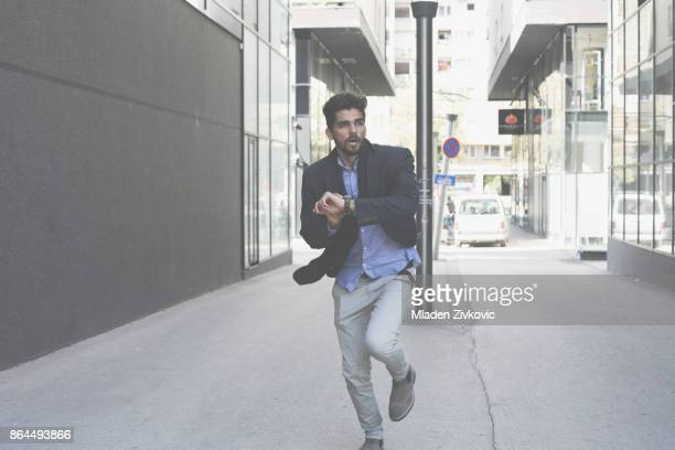 businessman hurry on work and checking time. - one young man only stock pictures, royalty-free photos & images