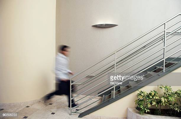 Businessman Hurrying up Stairs