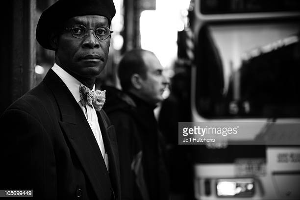 A businessman in a bowtie waits for a bus outside of Grand Central Station in Midtown Manhattan home to many of the world's banks on April 9 2009 in...