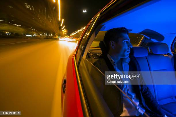 businessman in a cab - limousine stock pictures, royalty-free photos & images