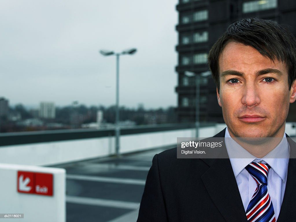 Businessman in a Car Park : Stock Photo