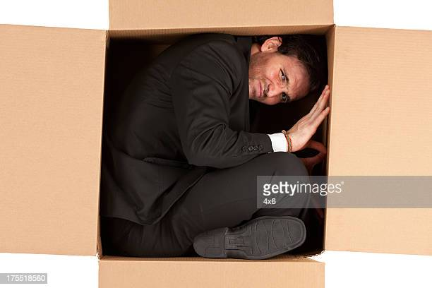 businessman in a cardboard box - contortionist stock pictures, royalty-free photos & images
