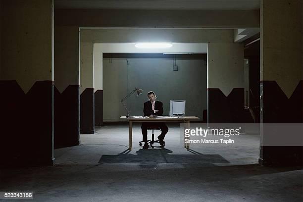 Businessman in a Dark Room