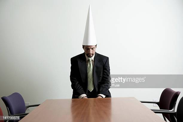 Businessman in a Dunce Cap