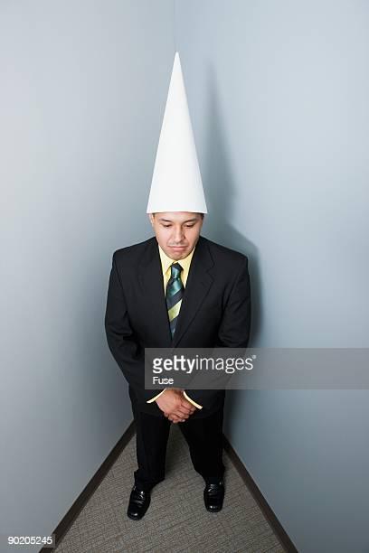 Businessman in a dunce cap