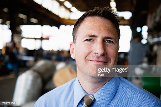 Businessman in a Factory