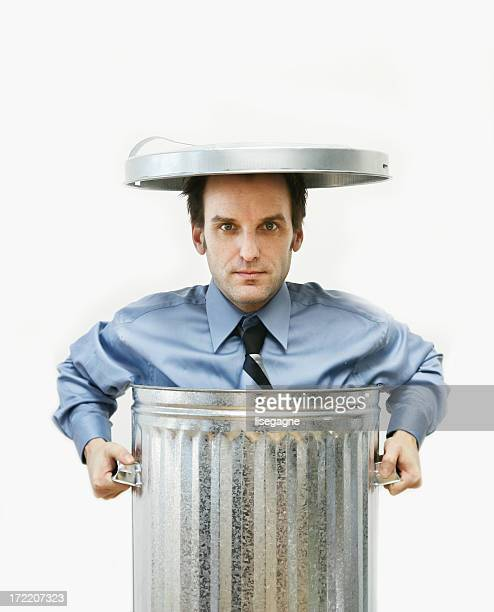 Businessman in a garbage can