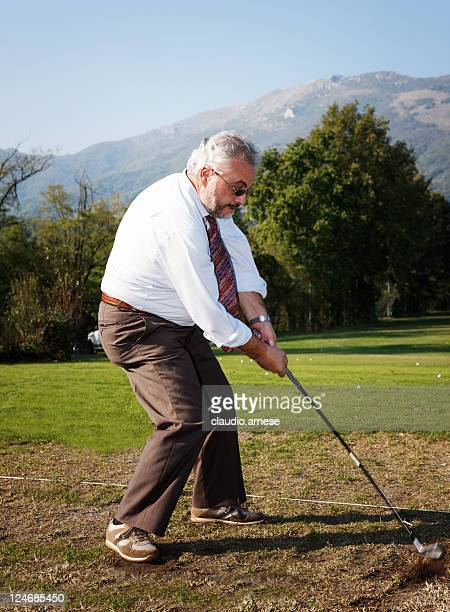 businessman in a golf course. color image - amateur stock pictures, royalty-free photos & images