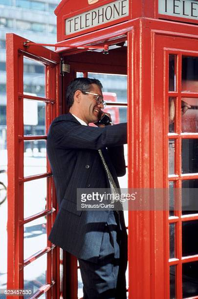 Businessman in a London phone booth