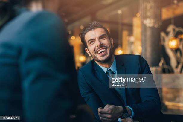 businessman in a meeting - high society stock pictures, royalty-free photos & images