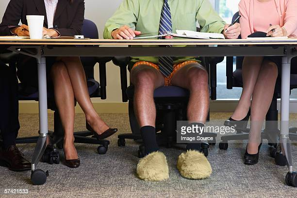 businessman in a meeting without any trousers - boxershort stock pictures, royalty-free photos & images