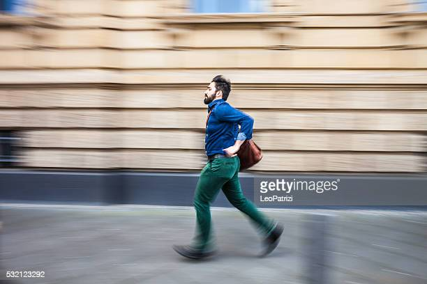 Businessman in a rush runs to the office