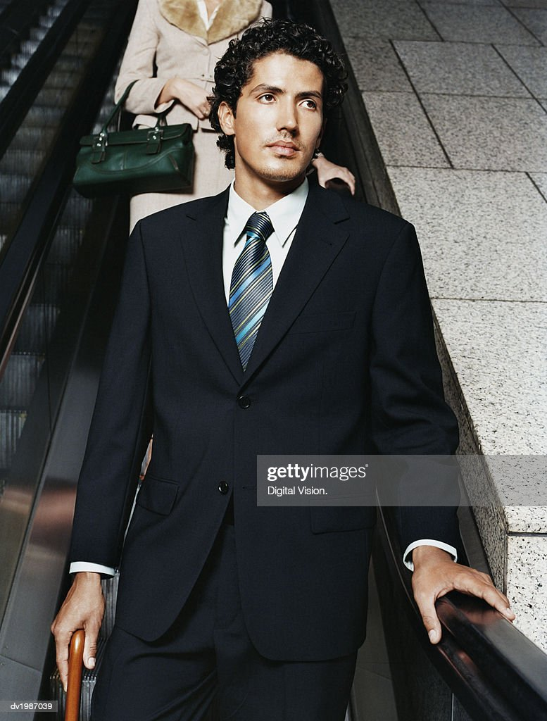Businessman in a Smart Suit on an Elevator : Stock Photo