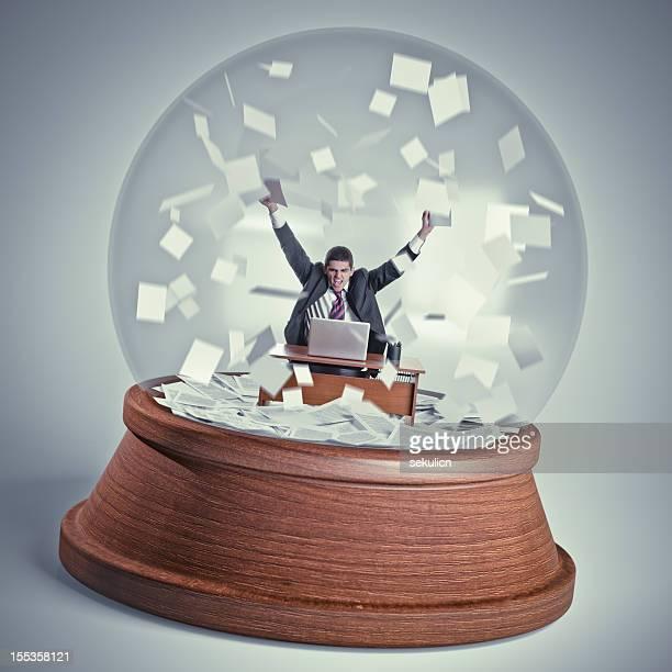 Businessman in a snowglobe