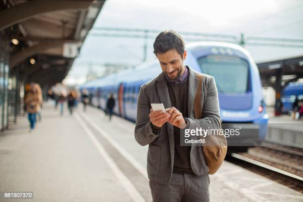 businessman in a train station - business travel stock pictures, royalty-free photos & images