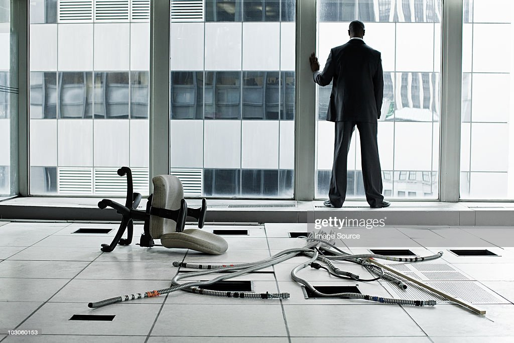 Businessman in abandoned office : Stock Photo