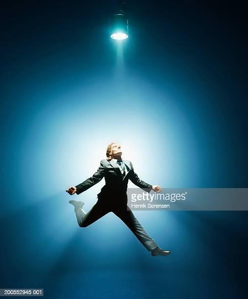 businessman in air, low angle view - schauspieler stock-fotos und bilder