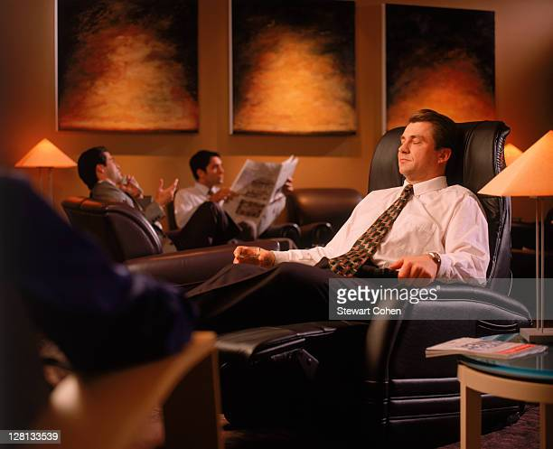 Businessman in airport lounge
