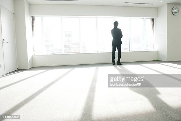 Businessman in an empty office, Tokyo Prefecture, Honshu, Japan