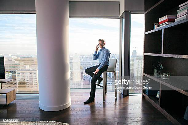 Businessman in apartment on the phone