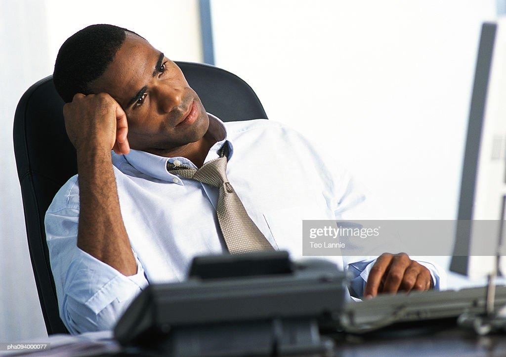 Businessman in armchair : Stockfoto