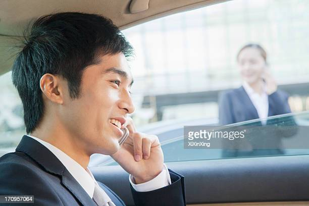 Businessman in Back Seat of Car on the Phone, Close Up