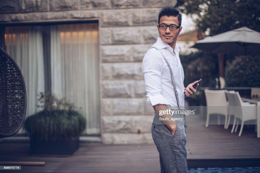 Businessman in back yard : Stock Photo
