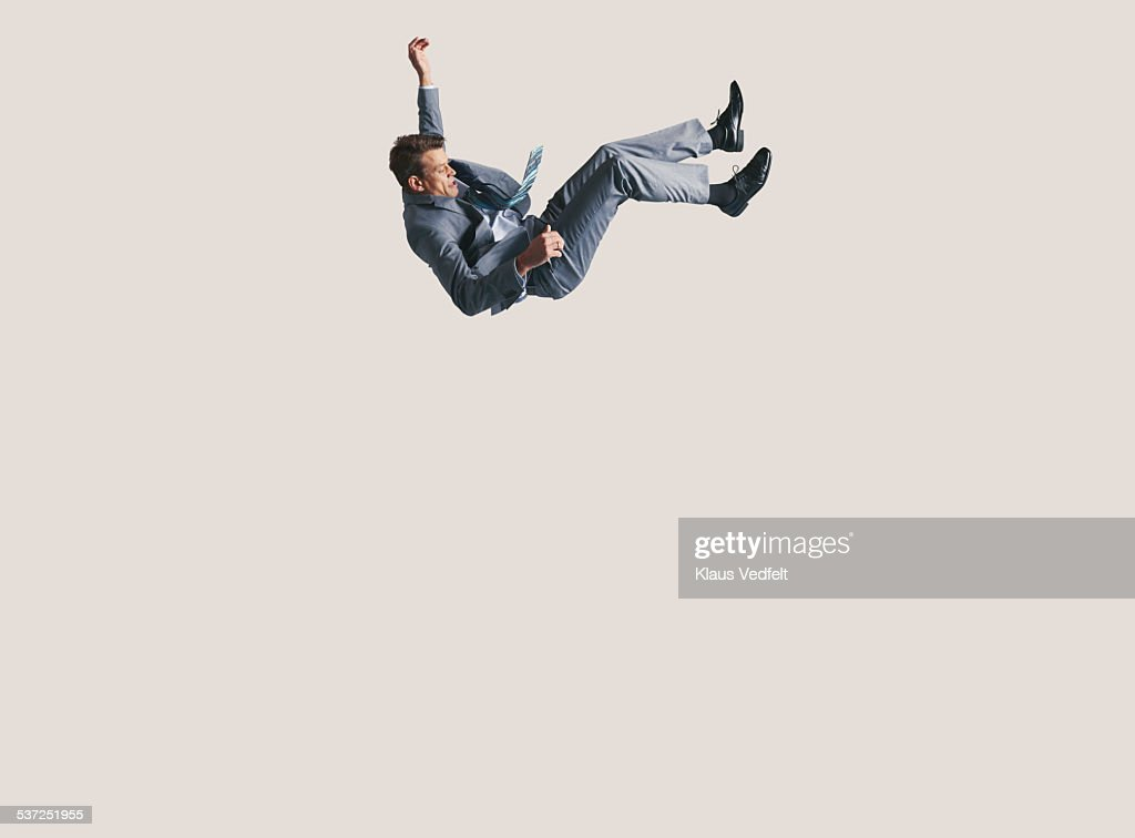 Businessman in big space, falling down : Stock Photo
