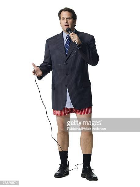 Businessman in boxers with microphone