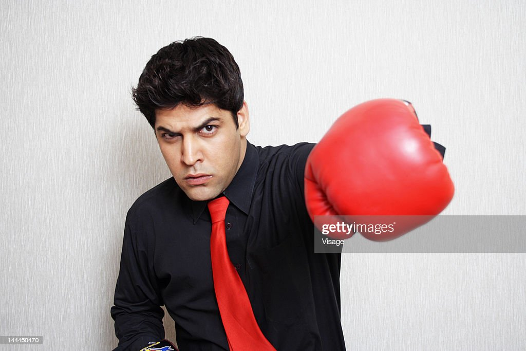 Businessman in boxing gloves : Stock Photo