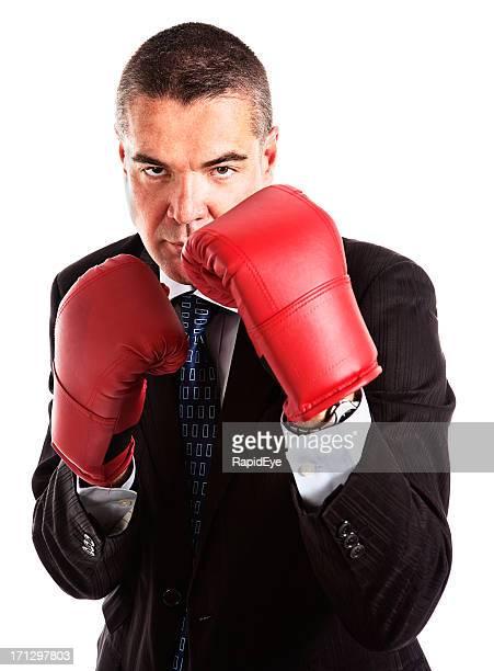 uomo d'affari di guanti da boxe pronti all'attacco o in difesa - difendere foto e immagini stock