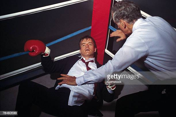 Businessman  in boxing ring