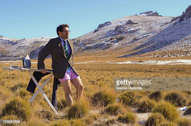 Businessman in briefs in patagonian steppe