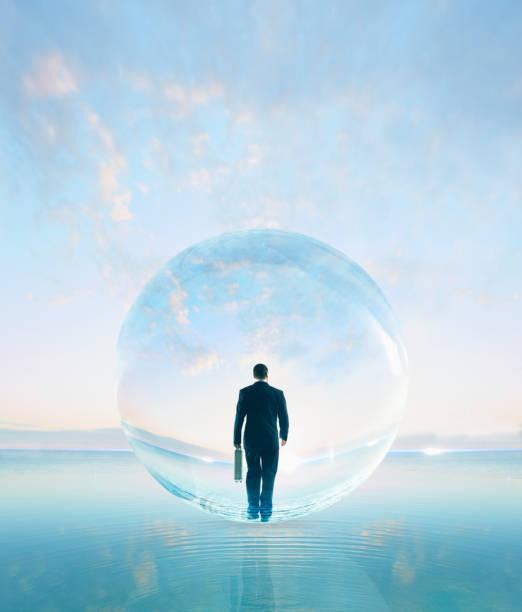 Businessman in bubble walking on water