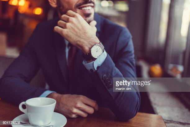 businessman in cafe looking through the window - wrist watch stock pictures, royalty-free photos & images