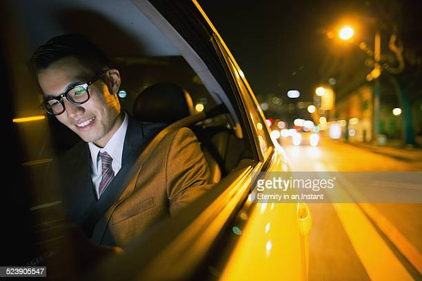 Businessman in car at night