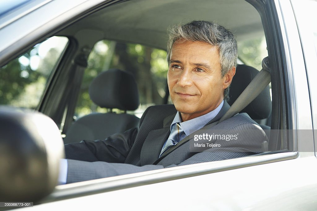 Businessman in car, close up : Stock Photo
