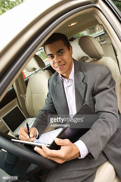 Businessman in car with appointment book