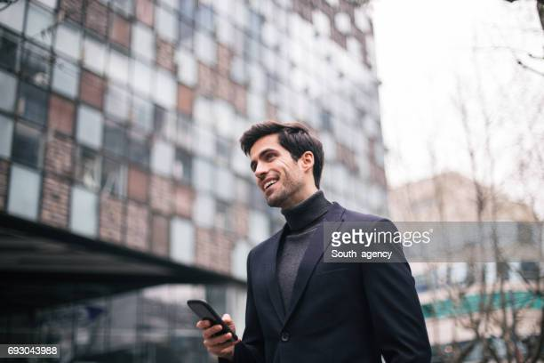 businessman in city - turtleneck stock pictures, royalty-free photos & images