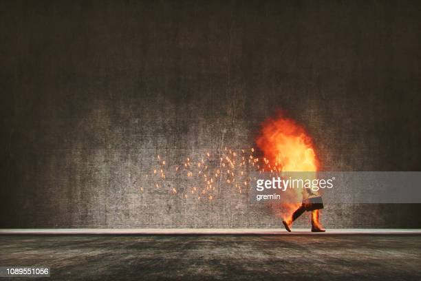 businessman in cloud computing digital flames walking on the street - gdpr stock pictures, royalty-free photos & images