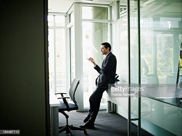 Businessman in conference room leading discussion