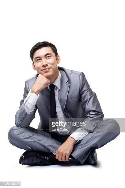 businessman in contemplation - 胡坐 ストックフォトと画像