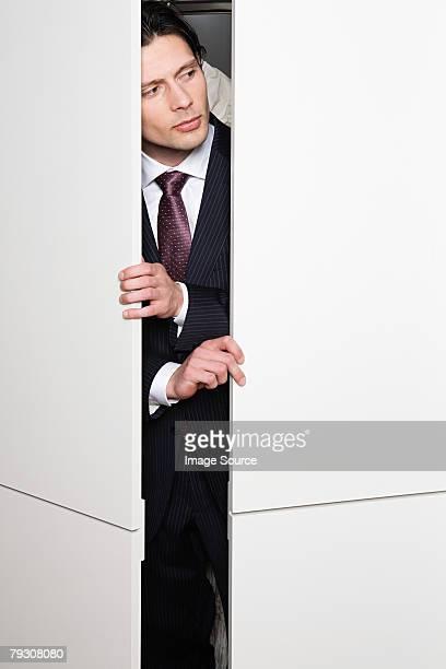 Businessman in cupboard