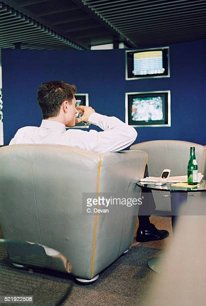 Businessman in Departure Lounge