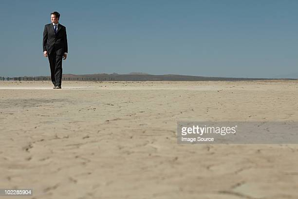 businessman in desert - lake bed stock photos and pictures