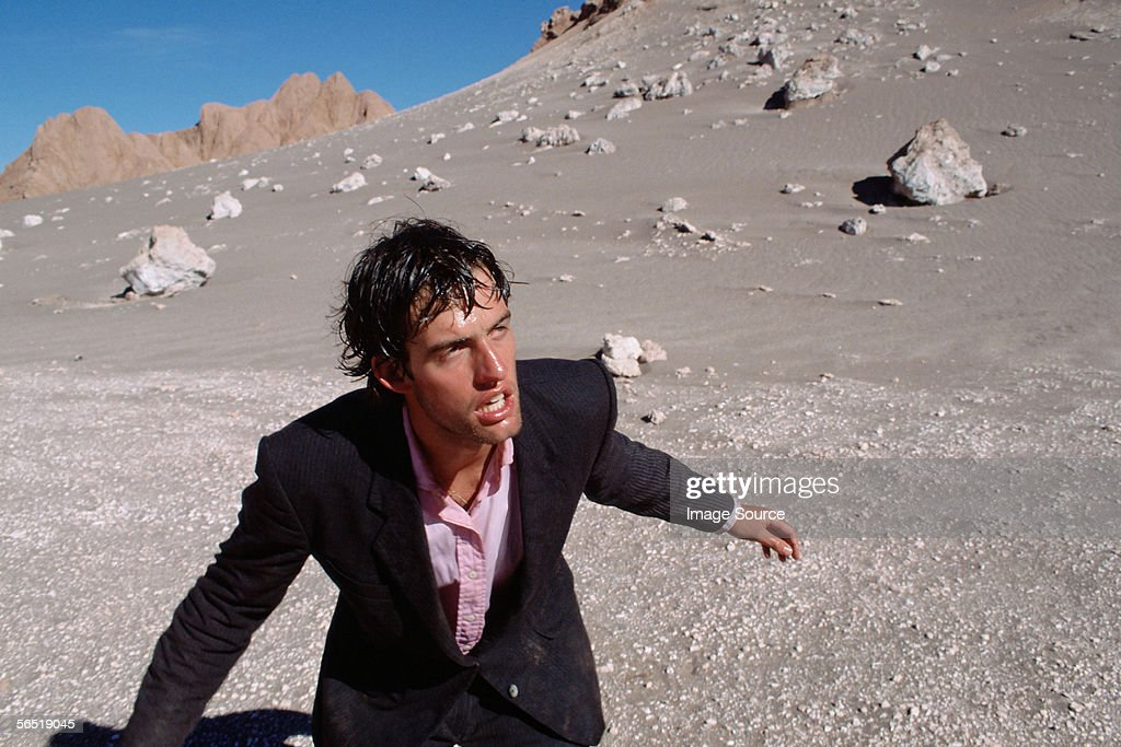 Businessman in desert : Stock Photo