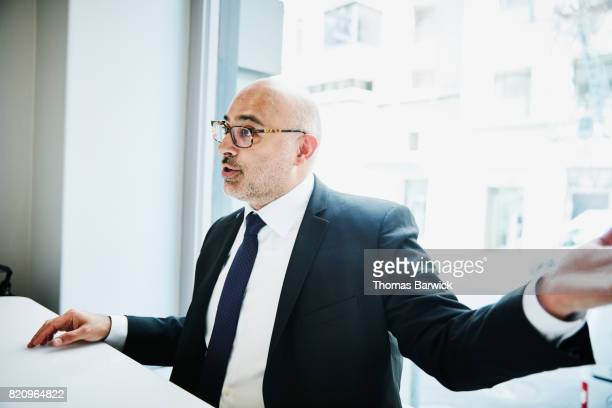Businessman in discussion during lunch meeting in cafe