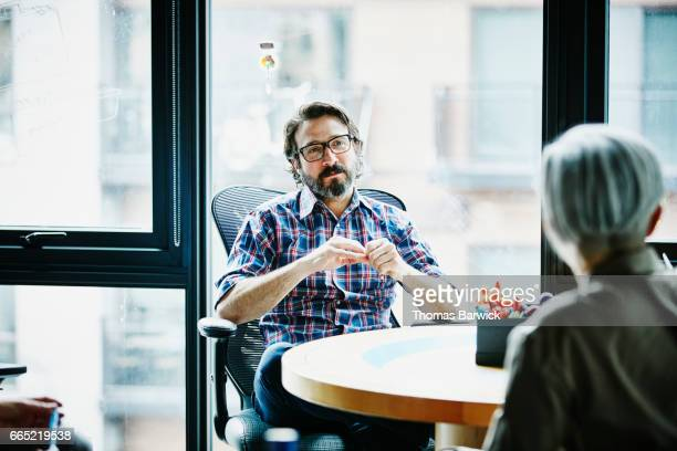 Businessman in discussion with client in office conference room