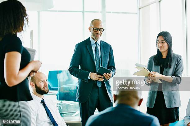 businessman in discussion with colleagues - incidental people stock pictures, royalty-free photos & images
