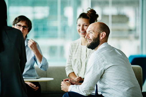 Businessman in discussion with colleagues - gettyimageskorea